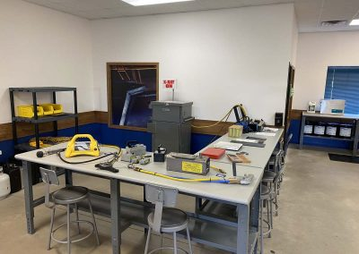 L-shaped workstation with testing equipment