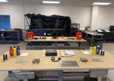 Training stations with tools and testing devices