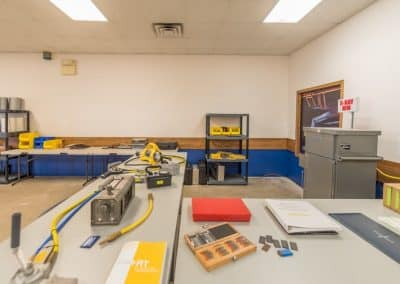 Workshop with testing devices, tools, and manuals
