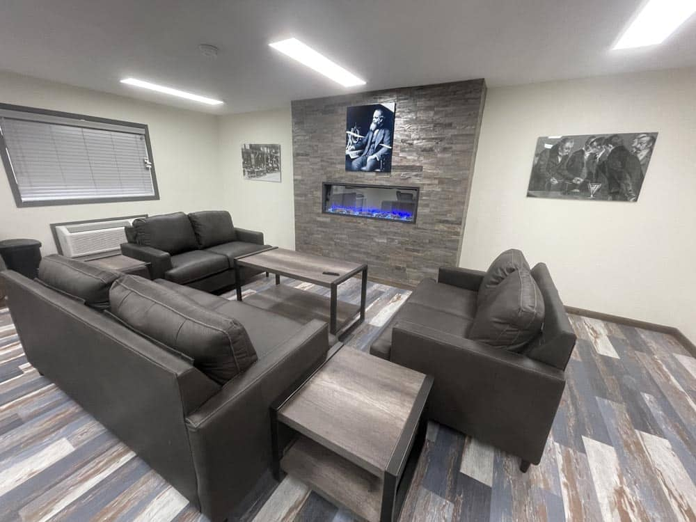 View of fireplace, couches and side tables