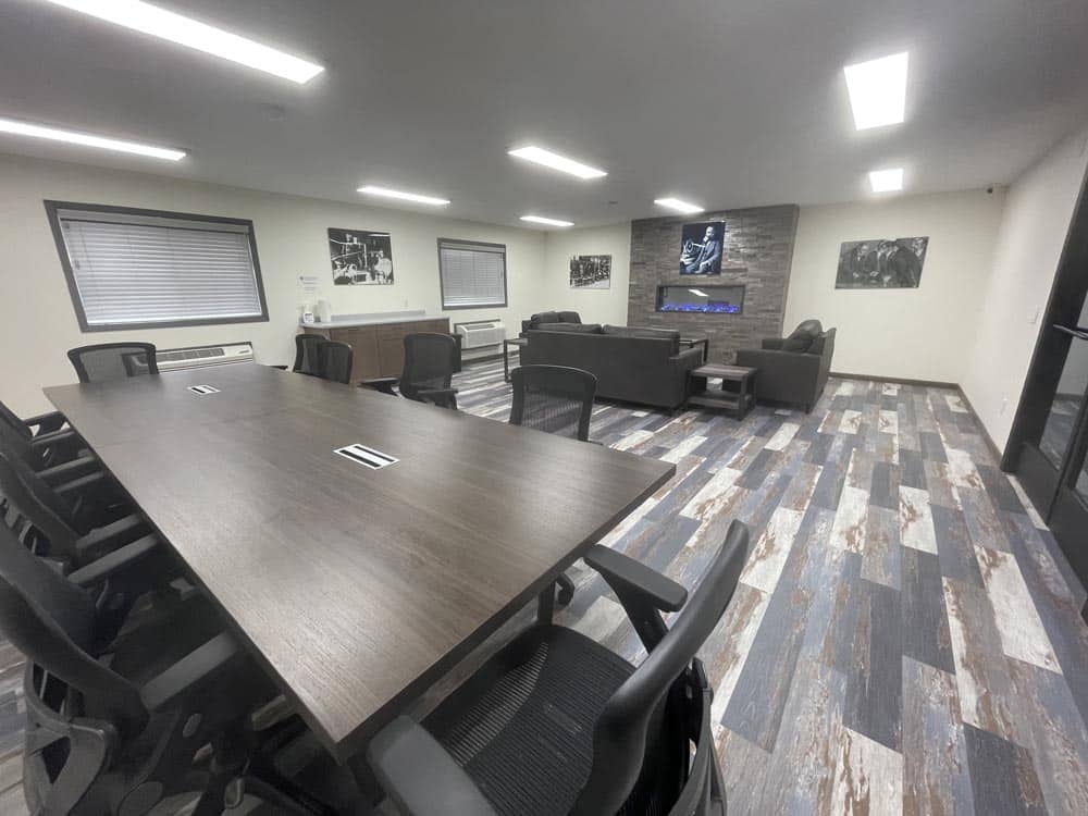 Large conference room with table, chairs and couches