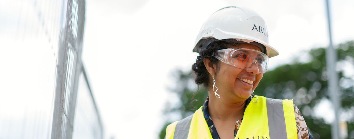 Smiling Woman in Hard Hat